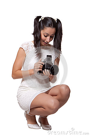 Retro woman with an old camera