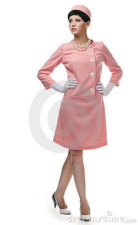 Retro woman in pink dress 60s