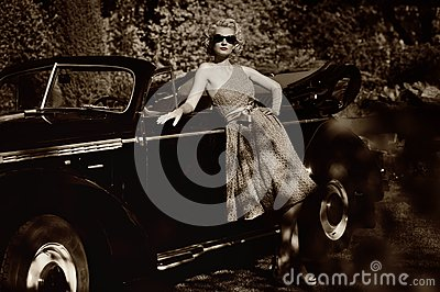 Retro woman standing near convertible