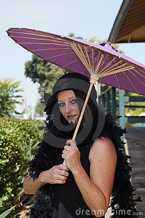 Retro Woman at Train Depot Holding Umbrella
