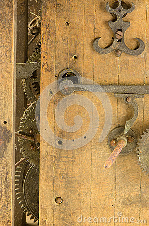 Retro wooden clock grunge mechanism gear closeup