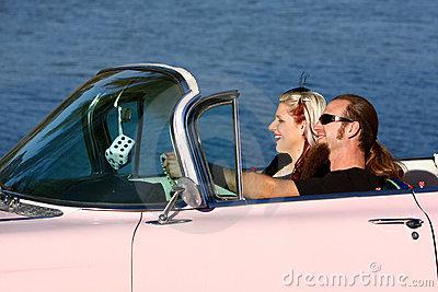 Retro young couple in pink Cadillac