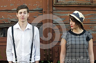 Retro young love couple vintage funny face industrial setting