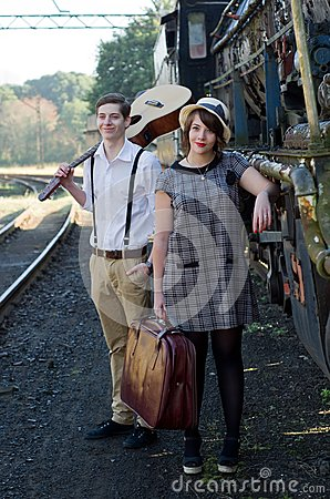 Retro young love couple vintage train setting