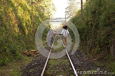 Retro young love couple vintage train tracks