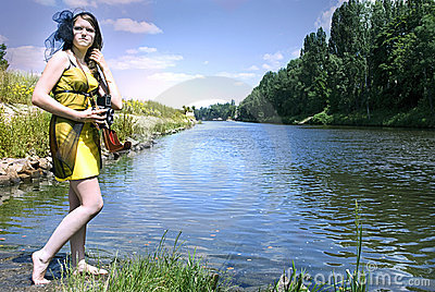Retro young woman  near the river
