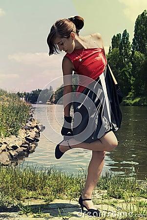 Retro young woman near the river