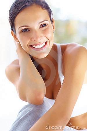 Retty young female in sportswear and smiling