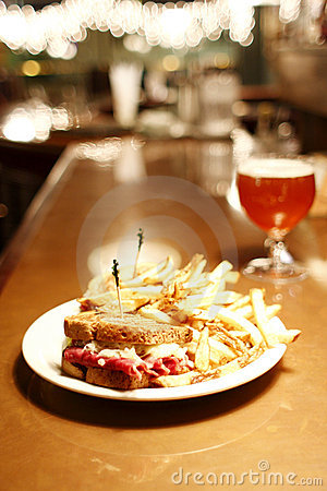 Reuben sandwich and a belgian beer