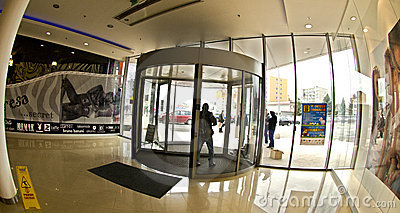 Revolving door to a new supermarket Stop Shop Editorial Stock Image