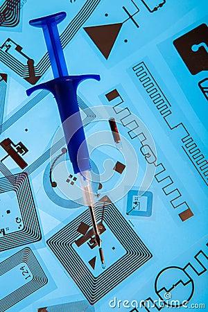 RFID implantation syringe and RFID tags Editorial Photography
