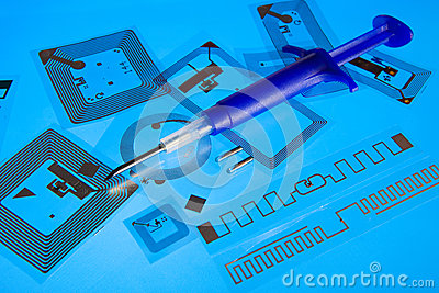 RFID implantation syringe and RFID tags Editorial Image