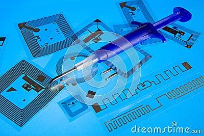 RFID implantation syringe and RFID tags Editorial Image