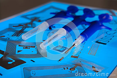 RFID implantation syringes and RFID tags Editorial Stock Image