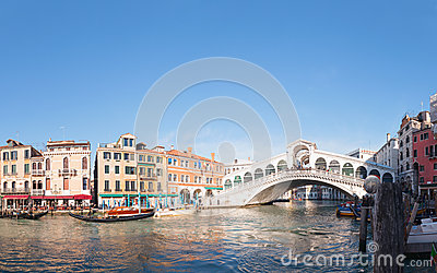 Rialto Bridge (Ponte Di Rialto) in Venice, Italy on a sunny day Editorial Stock Image