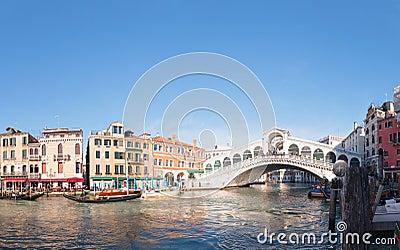Rialto Bridge (Ponte Di Rialto) in Venice, Italy on a sunny day Editorial Stock Image