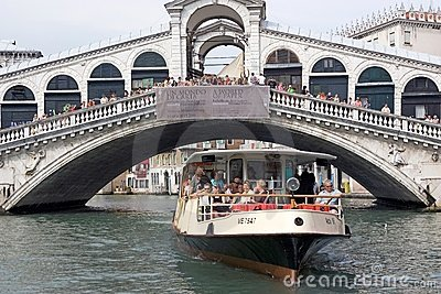 Rialto bridge and water bus Editorial Photo