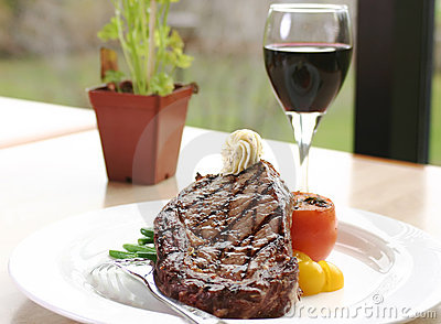 Rib Eye Steak served with wine