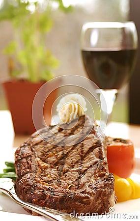 Free Rib Eye Steak Served With Wine Royalty Free Stock Photo - 188505