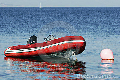 RIB, rigid inflatable boat moored at buoy