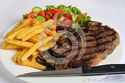 Ribeye steak dinner with knife