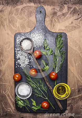 Free Rice, Cherry Tomatoes, Rosemary And Herbs, Wooden Spoon, Spices On A Cutting Board On Wooden Rustic Background Top View Close Up Royalty Free Stock Photos - 67535248