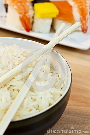 Rice and Chopsticks With Sushi