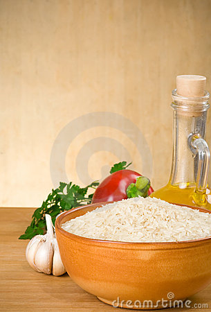 Rice and food ingredient on wood