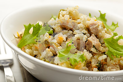 Rice with pork, carrots and spinach