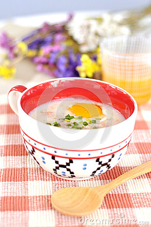 Rice porridge with egg in cute bowl