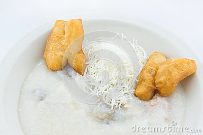 Rice porridge with with fried pastries in Thai style
