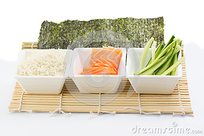 Rice salmon and sliced cucumber in white dish with nori on bamboo mat