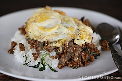 Rice topped egg with stir-fried pork and basil