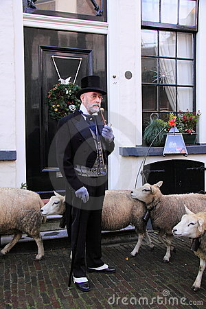 Rich man and sheep in the street Editorial Image
