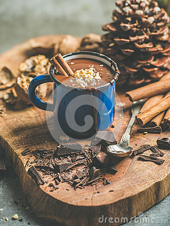 Free Rich Winter Hot Chocolate With Cinnamon And Walnuts In Mug Royalty Free Stock Photo - 95249965