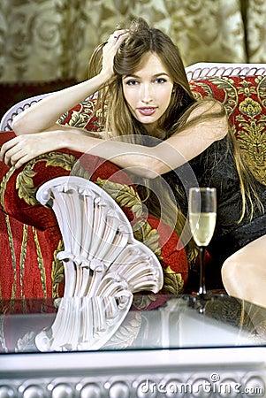 Rich woman near a coffee table