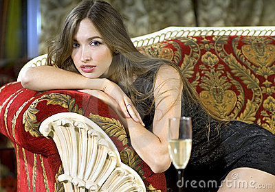 Rich woman on a red expensive sofa