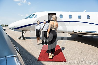 Rich Woman Walking Towards Private Jet