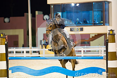Rider competes in horse jumping show Editorial Stock Photo