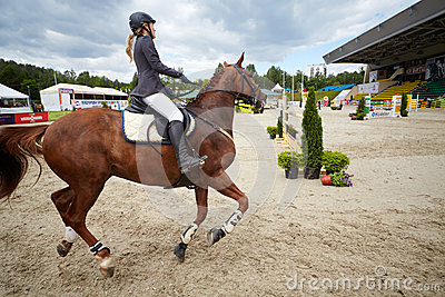 Rider on horse at competitions in show jumping CSI3 Vivat Editorial Stock Image