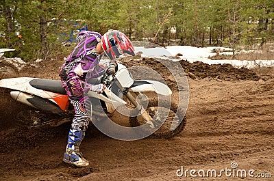 Rider stuck in deep ruts turning the sandy MX track