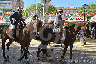 Riders at the fair in Seville Editorial Stock Image