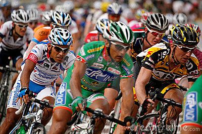 Riders in the final lap going into turn 1. Editorial Image