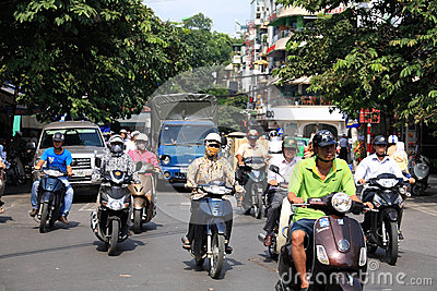 Riders ride motorbikes on busy road in Hanoi Editorial Stock Image