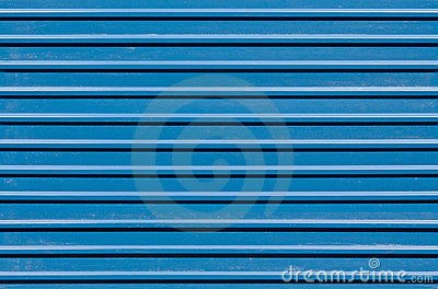 Ridged blue metal wall