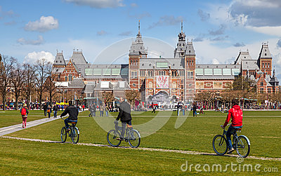 Riding Bicycles in Amsterdam Editorial Stock Photo