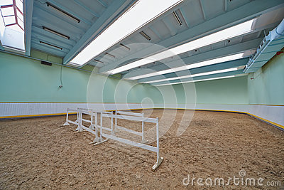 Riding hall with sandy covering