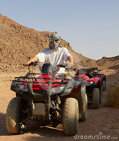 Riding quad bikes in desert