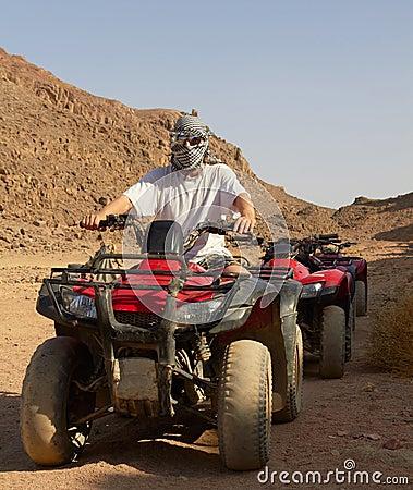 Riding quad bikes in desert