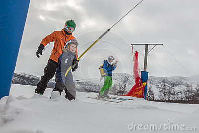 Riding the ski lift Editorial Photography
